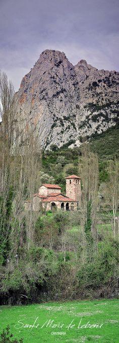 Santa María de Lebeña, una de las dos iglesias mozárabes de Cantabria. en ella se encuentra la Virgen dando el pecho al niño, algo bastante raro en la escultura medieval El tejo y el olivo milenarios siempre junto a la iglesia.