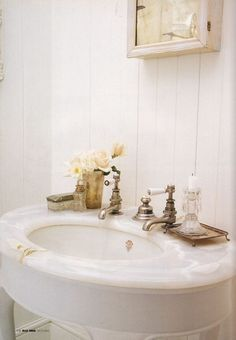 I love simple white in the bathroom.  It's bright and fresh.