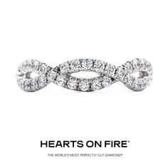 The Envelop Wedding Band- A stunning diamond wedding band with a delicate twist of Hearts On Fire diamonds is perfect on its own or paired with our Envelop Engagement Ring. #HOF