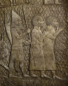 Officer conducts 2 Judeans to the King. Detail of the Assyrian conquest of the Jewish fortified town of Lachish (battle 701 BCE). Part of a relief from the palace of Sennacherib at Niniveh, Mesopotamia (Iraq)  British Museum