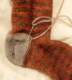 I want to know how to darn or mend  socks. I found this great (stills) tutorial on loop blog.