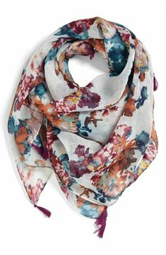 I actually own this scarf.  It's several years old and tattered because I've worn it so much!  Pairs well with a gray sweater and jeans, to a navy tee and white pants.  It's also a good size for me; lightweight enough for spring and not overwhelmingly large for my frame.  The square shape works great!