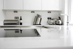 High gloss white kitchen: Site your working kitchen area close to a natural light source (where possible) and you will benefit from a bright, inviting and functional kitchen space that also emphasises the appreciable shine of your gloss kitchen surfaces.