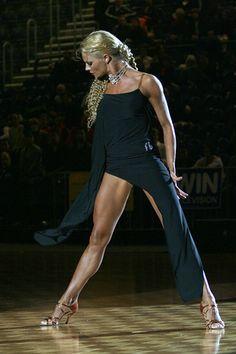 Simple black dress with asymmetric cut skirt worn by Yulia