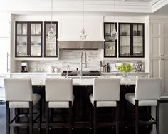 Contemporary Kitchen. Great use of cabinet space. The white makes the space feel larger.