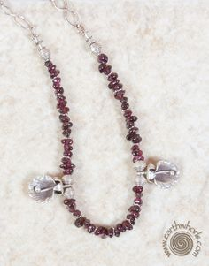 http://earthwhorls.com/product/garnet-hill-tribe-and-sterling-silver-necklace/  Tis the season - we've got the reason - 30% off with code HoHoHo - free shipping!