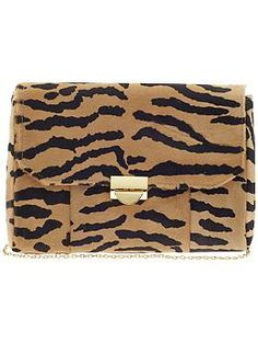 W-I-L-D about this Lauren Merkin Mini Marlow Zebra Calf Hair clutch! Add it to any outfit and you've got instant panache.