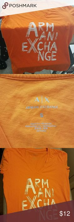 🍭ARMANI EXCHANGE TOP🍭 Orange Armani Exchange Beautiful Top! When I bought this top, it was one of my favorites! I only had the chance to wear it less than a handful of times! This top is PERFECT, NO FLAWS! I am always open to reasonable offers, my prices aren't final unless stated! I Always Consider the high shipping cost! I trade as well  (under certain conditions, because I've been scammed...Twice)... Thanks for browsing through my closet!! :) Armani Exchange Tops Tees - Short Sleeve