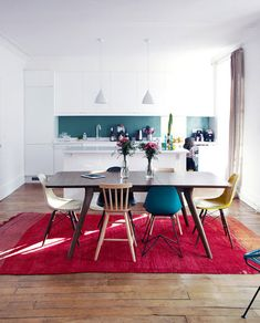 Mismatched chairs with Eames shell chairs. I can't decide on a set of dining chairs so think this might be the way to satisfy all my chair cravings!
