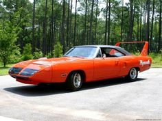 "orange 60's Mopar ""Muscle Car"" with oversize spoiler"