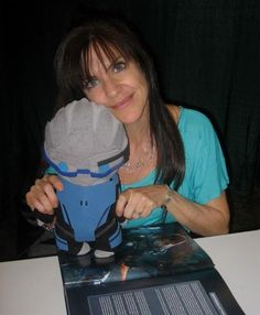 Jennifer Hale (voice actor of FemShep) poses with her biggest fan, Garrus!    Garrus plushie by: ViciousPretty