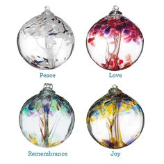 Vibrant hand blown recycled glass globes by Stephen Kitras. Collection features Tree of Remembrance, Tree of Peace, Tree of Joy and Tree of Love.
