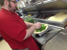 The creation of a masterpiece! New Grilled Chicken Florentine pizza being created by a Marco's pizza maker!