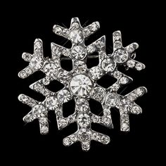 Sparkle up your holiday with this decorative antique silver snowflake pin!