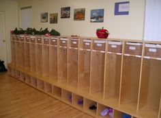 Cubbies for personal belongings that are near the classroom door, labeled with the children's names that offer their own space.