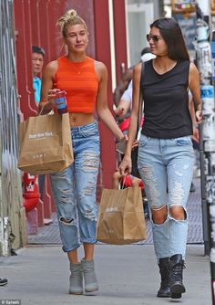 Edgy style: Kendall Jenner wore ripped jeans and black combat boots as she browsed the shops in Soho, New York on Wednesday with good friend...