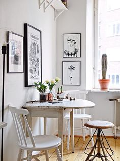 White furniture. Dining or breakfast area. Small apartment ideas