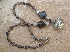 Smokey Quartz, Pearl & Garnet necklace  http://www.indalomart.com/index.php/inspirational-presents-with-meaning-gifts-shop#!/~/product/id=1243397
