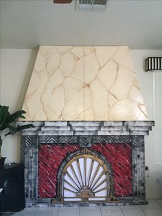 Magalie Sarnataro's prop Halloween 2017 The Hollywood Tower Hotel fireplace : foam, paint, missing wall HTH hanging and lights/ burning charcoal