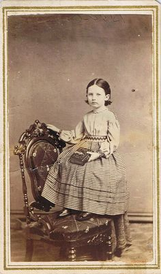 CdV of Ada E. Johnston, holding an album in her hand. Photographed by H. Malin at Howe's, Jamestown, N.Y., USA, ca. 1865.