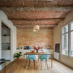This cosmopolitan apartment is located in a turn of the century building on an iconic chamfered corner of Barcelona, Spain's Eixample District.