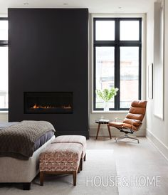 With its clean-lined fireplace and edited selection of furniture, this bedroom makes a striking impression. Plush textiles and leather help soften the space's hard edges. | Design: Ali Yaphe, Mazen El-Abdallah | Photo: Donna Griffith
