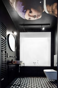 Wow what a bathroom! Black and white with the Girl with a pearl earring on the ceiling.