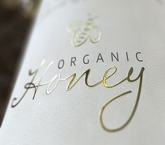 v nice font on a beautifully packaged bottle of honey