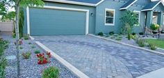 The curved accent on this driveway softens the straight lines and looks great with this home. Designed by Sterling Landscape Design & Construction in Nampa, ID.