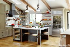 Salvaged wood, raw steel, and glazed brick give a St. Helena, California, kitchen designed by Dan Doyle a sturdy, industrial look.