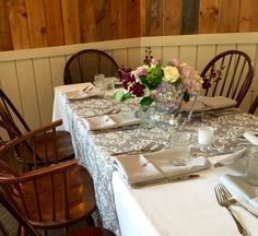Floral centerpiece and table scape for a wedding in the York Room at Foster's Clambakes and Catering. #yorkmaine #weddingvenue #mainevenue #mainewedding #yorkweddings #