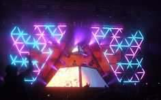 Daft Punk stage pink blue triangles.