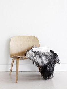 Office inspiration! Tan chair, fur shrug, magazines.