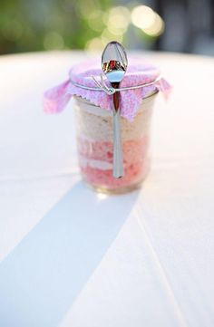 Who could ever go wrong with cake in a mason jar? That would be a great way to have your cake handy, you could even take it out of the dance floor! :)