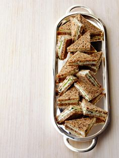 Food Network invites you to try this Herbed Goat Cheese Sandwiches recipe from Ina Garten.