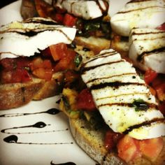 """Caprese Bruschetta with Balsamic Reduction - I'll layer French bread baguette slices (1/2"""" thick/lightly toasted) first with the freshly sliced mozzarella, next with the tomato mixture, & then with drizzled balsamic."""