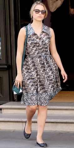 Dianna Agron left her London hotel in a mixed-print shirtdress, green shoulder bag and ballet flats.
