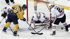 Chicago Blackhawks goalie Ray Emery (30) and defenseman Duncan Keith (2) block a shot attempt by Nashville Predators right wing Patric Hornqvist (27), of Sweden, in the third period of an NHL hockey game on Saturday, April 6, 2013, in Nashville, Tenn. The Blackhawks won 1-0. (AP Photo/Mark Humphrey)