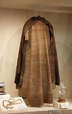 Saint Clare Of Assisi - tunic and mantle displayed. I saw this in Assisi & was amazed at how big & heavy it is.
