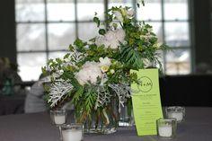 Reception centerpieces, white peonies, white freesia, buplurum, winter greens, dusty miller.  Jan 3  Shadowland ballroom.
