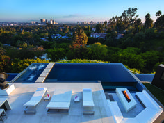 This private Beverly Hill's infinity pool offers a spectacular view and has a sleek and modern feel, perfect for entertaining or just relaxing. 1201 Laurel Way   Beverly Hills