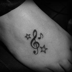 Music Tattoo Designs: Music note tattoos on foot