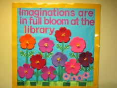"Spring Library Bulletin Board, ""Imaginations are in full bloom at the library."""