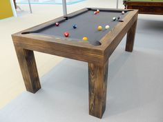 Bespoke pool table at the House & Garden Festival made from blackened Southern Yellow Pine and hand-scraped for a stunning finish. UK pool table - size billiard table - top quality slate, cloth and rubbers. Dining Room Pool Table, Pool Table Sizes, Pool Table Top, Custom Pool Tables, Diy Table Top, Pool Sizes, Cheap Pool Tables, Dining Tables, Billiard Room