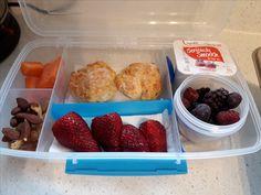 Cheese scones, mixed nuts, carrot sticks, strawberries, frozen berries and yogurt