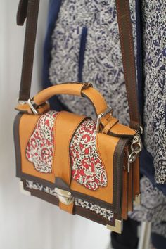 I think this is a collaboration with Liberty fabrics, but I can't remember who actually makes this bag