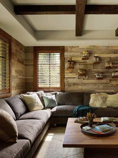 Love the plank wall with collectibles in this living room. #sectional #livingroom #decor
