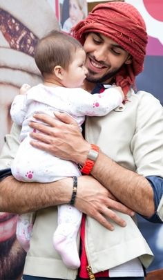 Omar Borkan Al Gala. Hot guy +  baby =  Me swooning...wishful thinking that possibly may be haram