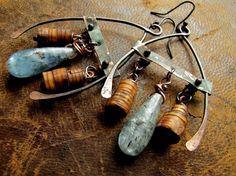 rhapsody on a windy night - placid metalwork earrings.