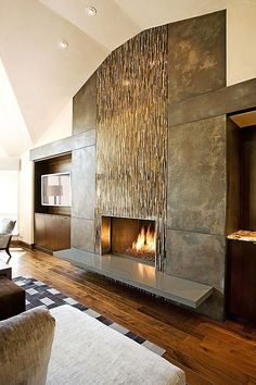 Contemporary Living Room with High ceiling, Metal fireplace surround, Hardwood floors, Wood paneled wall, Custom design Metal Fireplace, Farmhouse Fireplace, Home Fireplace, Modern Fireplace, Fireplace Surrounds, Fireplace Design, Glass Tile Fireplace, Fireplace Facing, Simple Fireplace